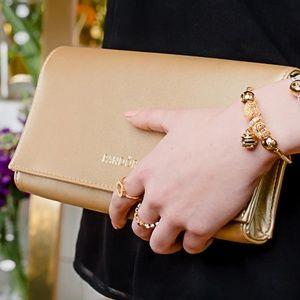 NIB Pandora gold clutch